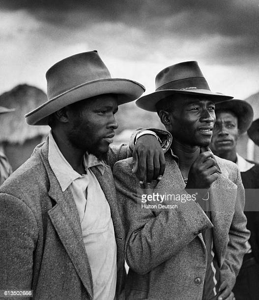 Identifiable by their budding beards, young teachers who support Seretse Khama, and who are in his regiment, attend a meeting in Serowe.