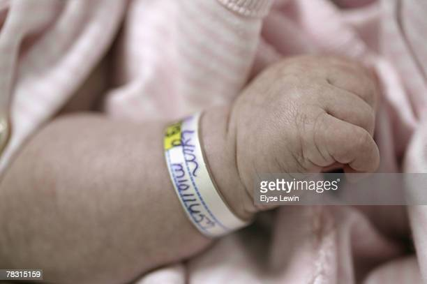 Identification wrist band on newborn baby