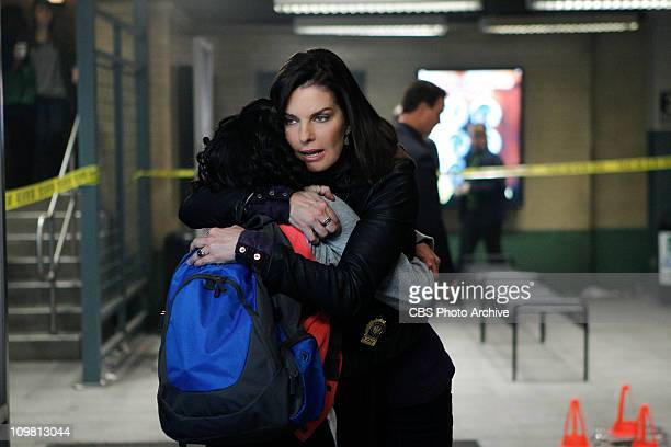 Identity Crisis Det Josephine Jo Danville embraces her adopted daughter Ellie after she becomes a key witness in a murder investigation on CSINY...