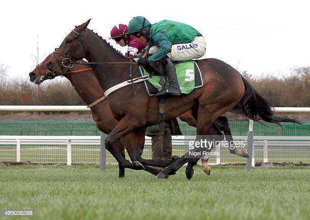Identity Thief riden by Bryan Cooper jumps on his way to winning The StanJamescom Fighting Fifth Hurdle race ahead of Top Notch ridden by Daryl Jacob...
