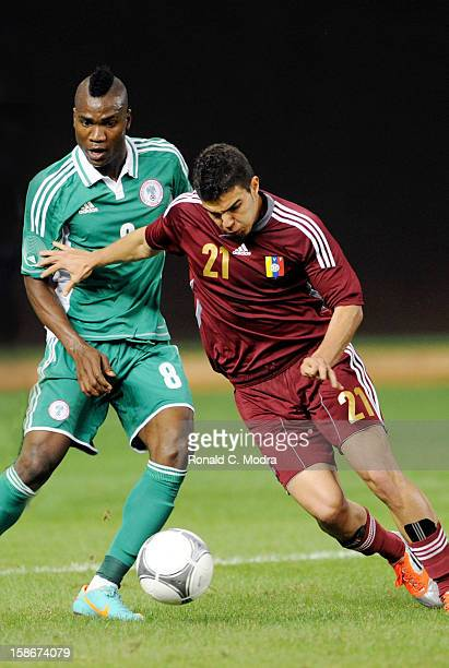 Ideye Brown of the Nigeria Soccer Team and Alexander Gonzalez of the Venezuela National Soccer Team in action during an exhibition game at Marlins...