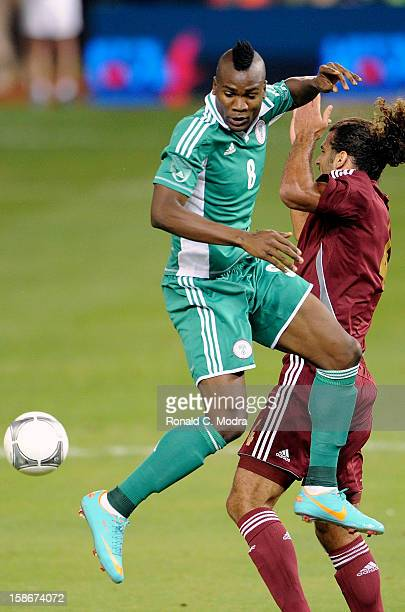 Ideye Brown of the Nigeria Soccer Team in action during an exhibition game against the Venezuela National Soccer Team at Marlins Park on November 14...