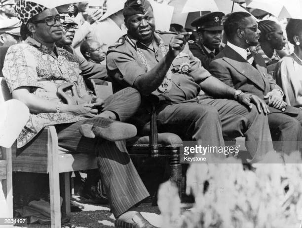 Idi Amin President of Uganda with President Mobutu Sese Seko of Zaire previously Joseph Desire Mobutu watching a military parade in Kampala