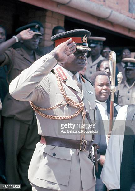 Idi Amin third president of Uganda saluting at the state funeral of King Freddie who was its first president and the King of Buganda circa April 1971...