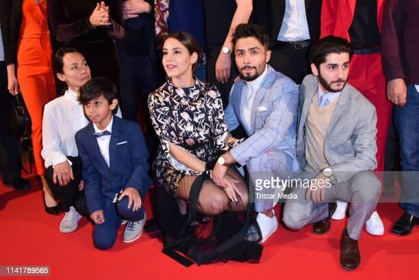 Idil Uener, Almila Bagriacik, Aram Arami and Rauand Taleb attend the 'Nur eine Frau' premiere at Kino International movie theater on May 6, 2019 in...