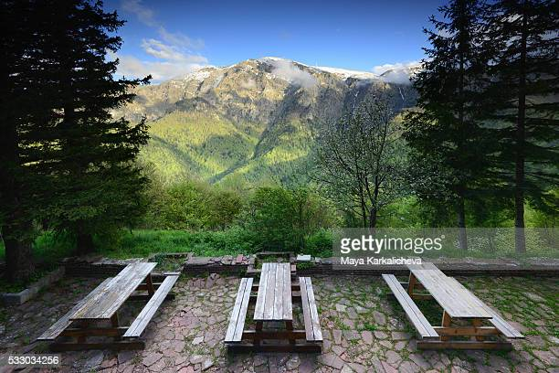 Idillyc scene of three picnic tables on an amazing mountain view