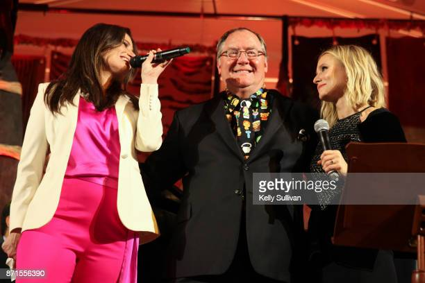 Idina Menzel and Kristen Bell perform You've Got a Friend In Me onstage with John Lasseter recipient of the Diane Disney Miller Lifetime Achievement...