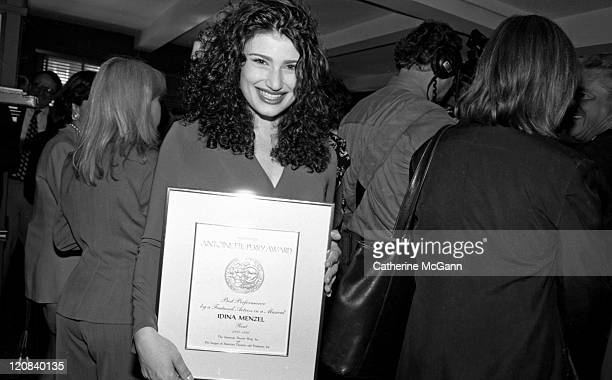 Idina Menzel of the original cast of the Broadway musical 'Rent' poses for a photo at the Tony Award nominations in 1996 in New York City New York...