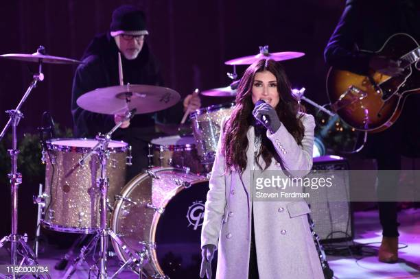 Idina Menzel performs onstage at the 87th Annual Rockefeller Center Christmas Tree Lighting Ceremony at Rockefeller Center on December 04 2019 in New...