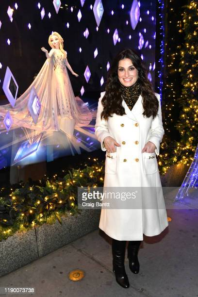 Idina Menzel poses during the Disney and Saks Fifth Avenue unveiling of Disney Frozen 2 holiday windows on November 25 2019 in New York City