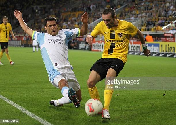 Idir Ouali of Dresden battles for the ball with Grzegorz Wojtkowiak of Muenchen during the Second Bundesliga match between SG Dynamo Dresden and 1860...
