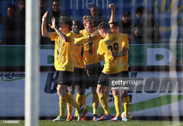 Idir Ouali of Dresden celebrates with his team mates after scoring his team's first goal during the Second Bundesliga match between FC St. Pauli and...