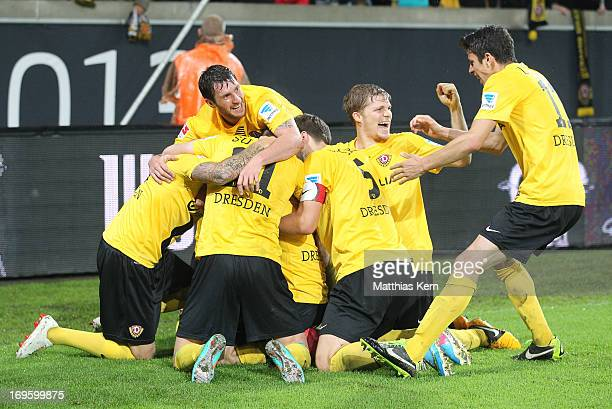 Idir Ouali of Dresden jubilates with team mates after scoring the second goal during the Second Bundesliga playoff second leg match between SG Dynamo...