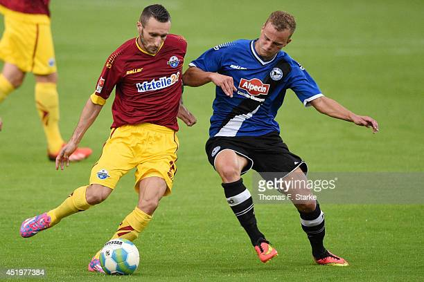 Idir Ouali of Paderborn and Christoph Hemlein of Bielefeld fight for the ball during the friendly match between Arminia Bielefeld and SC Paderborn at...