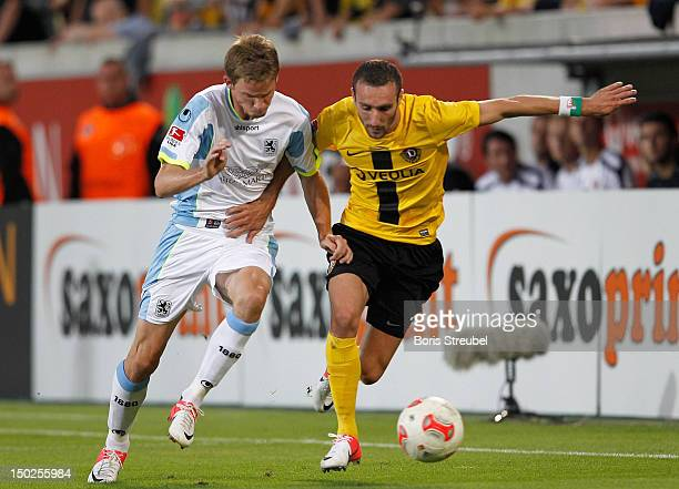 Idir Quali of Dresden battles for the ball with Marin Tomasov of Muenchen during the Second Bundesliga match between SG Dynamo Dresden and 1860...