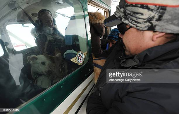Iditarod Air Force pilot Danny Davidson left prepares to leave Nikolai airport with a load of dropped dogs on Wednesday March 6 during the Iditarod...