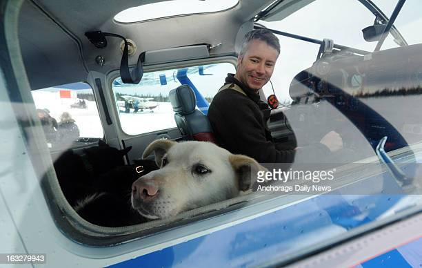 Iditarod Air Force pilot Scott Ivany prepares to leave the Nikolai Alaska airport with a load of dropped dogs on Wednesday March 6 during the...