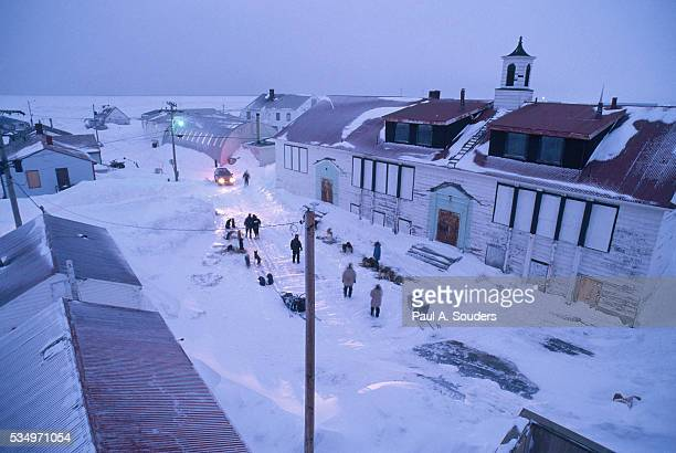 iditarod teams camping in town - iditarod stock pictures, royalty-free photos & images