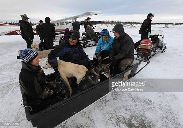 Iditarod volunteers bring dropped dogs to the Nikolai Alaska airport on Wednesday March 6 during the Iditarod Dog Sled Race