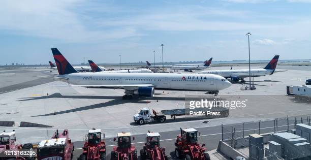 Idle airplanes of Delta airline seen during COVID-19 pandemic at JFK airport.