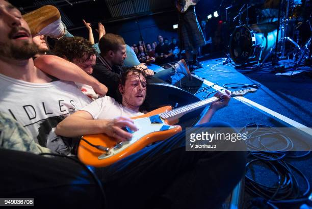 Idles guitarist Lee Kieran in the crowd as the band performs at Gorilla on April 18 2018 in Manchester England