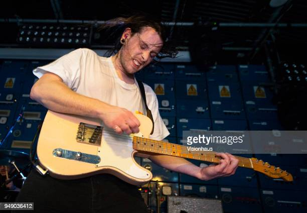Idles guitarist Lee Kieran performs with the band at Gorilla on April 18 2018 in Manchester England