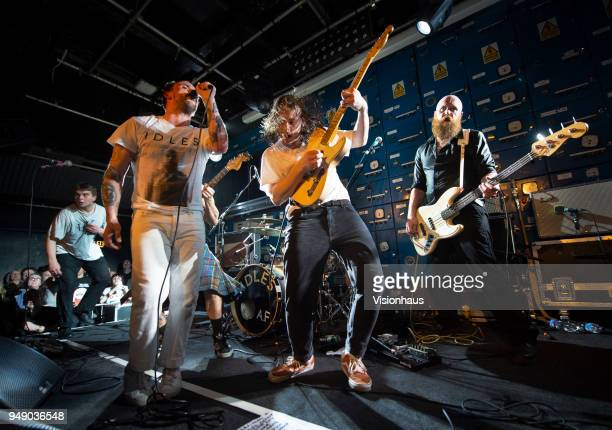 Idles with lead singer Joe Talbot guitarist Lee Kieran and Adam Devonshire on bass perform at Gorilla on April 18 2018 in Manchester England