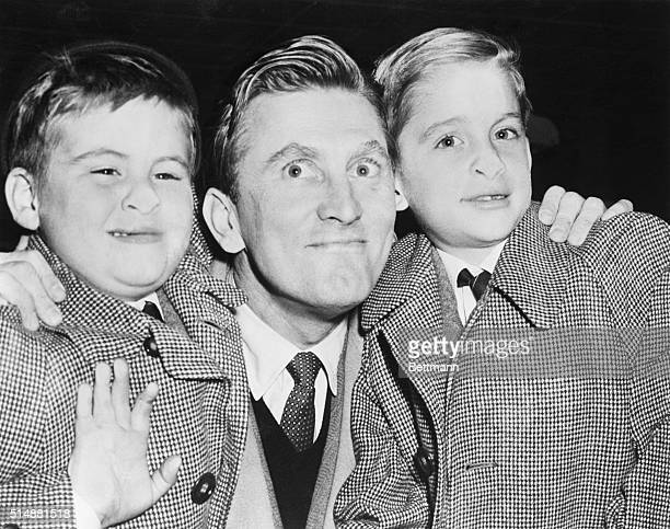 12/15/53 Idlewild Airport New York Joel Douglas left and Michael Kirk right make funny faces for the cameraman with noses pressed against the glass...