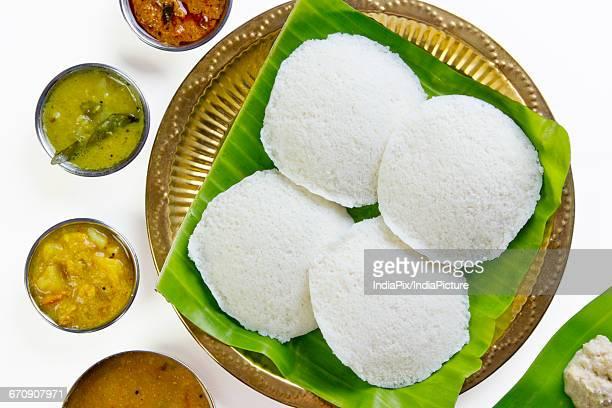Idli in a plate with chutney and sambar