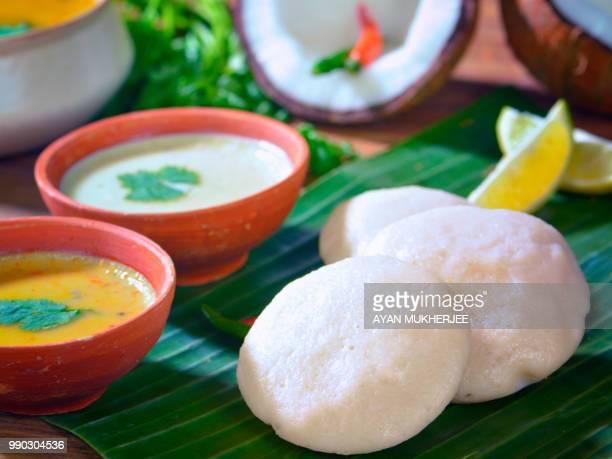 Idli served on a banana leaves with chutney,sambar