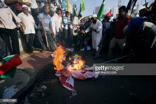 Idnian Muslims burn an American flag as they protest against an antiIslam film made in the United States on September 18 2012 near the American...