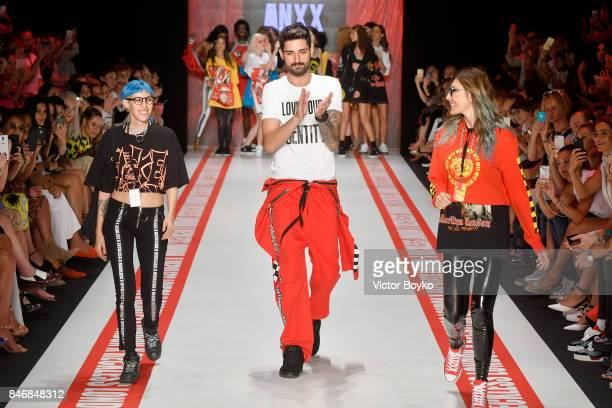 Ido Tatlises walks the runway with models at the DB Berdan show during MercedesBenz Istanbul Fashion Week September 2017 at Zorlu Center on September...