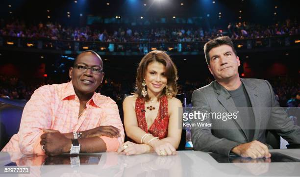 Idol Judges Randy Jackson Paula Abdul and Simon Cowell pose at the 'American Idol' final performance show at the Kodak Theatre on May 24 2005 in Los...