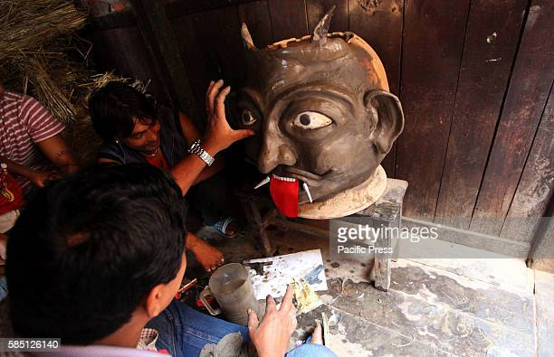 Idol of demon is prepared for setting fire during the celebration of Ghantakarna festival in Bhaktapur, Nepal. Ghantakarna festival is celebrated in...