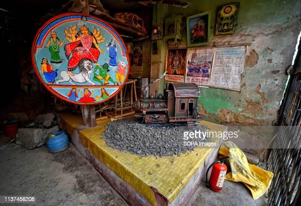 Idol of Hindu goddess Lakshmi seen on a bigger canvas in a store of Kumortuli during the occasion. Artists from Kumortuli, the artisan hub of Kolkata...