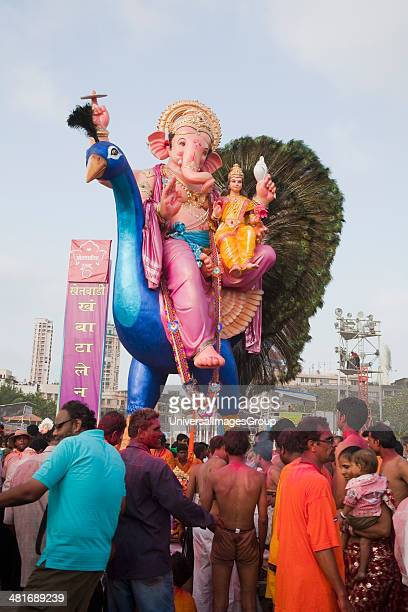 Idol of Lord Ganesha representing Lord Vishnu at immersion ceremony, Mumbai, Maharashtra, India.