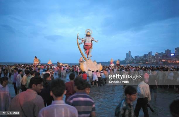 Idol of lord Ganesha (elephant headed god), Visarjan ceremony 2008, Girgaum Chowpatty beach, Bombay Mumbai, Maharashtra