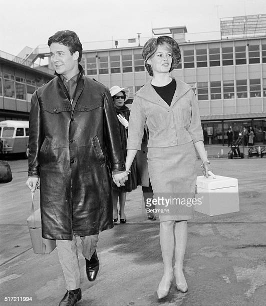 Idol of the French cinema public Brigitte Bardot walks with husband Jacques Charrier here before boarding a plane for Lisbon today Brigitte or BB as...