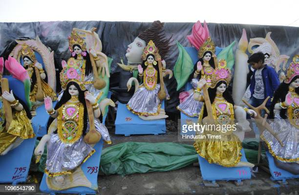 Idols are seen at a makeshift shop ahead of the upcoming Saraswati Puja at Sector 20 on February 9 2019 in Noida India Basant Panchami or Vasant...