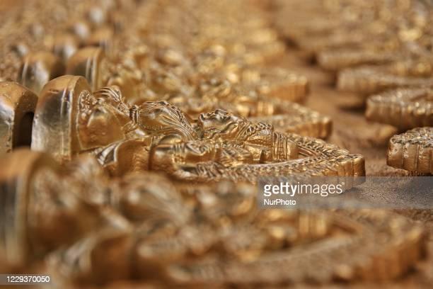 Idols of Hindu Goddess Laxmi and God Ganesha being prepared ahead the Diwali festival in Jaipur, Rajasthan, India, on October 30, 2020. Diwali is the...