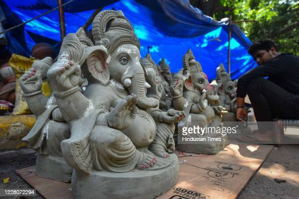 Idols of the Hindu god Ganesha being made for the upcoming Ganesh Chaturthi festival at Sarojini Nagar on August 16 2020 in New Delhi India
