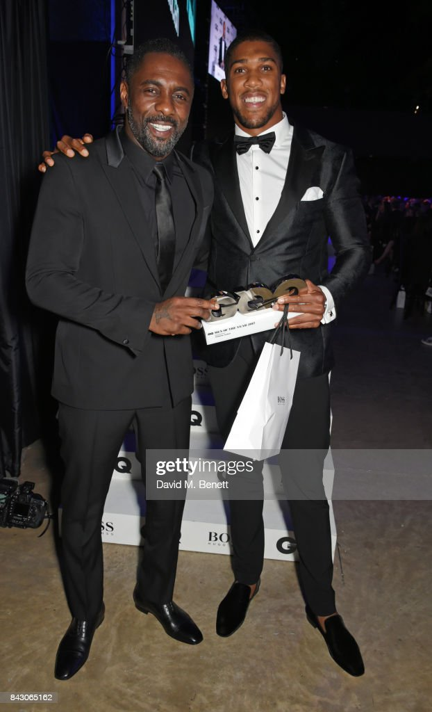 Idris Elba (L) and Anthony Joshua, winner of the Sportsman of the Year award, attend the GQ Men Of The Year Awards at the Tate Modern on September 5, 2017 in London, England.