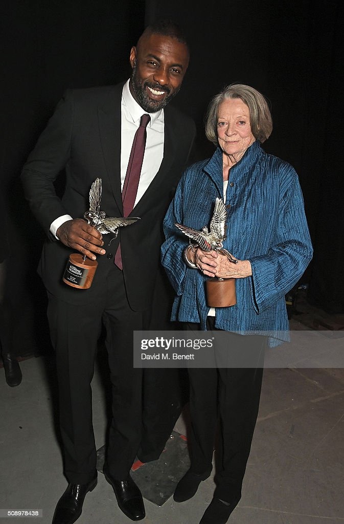 Idris Elba and Dame Maggie Smith attend the London Evening Standard British Film Awards at Television Centre on February 7, 2016 in London, England.