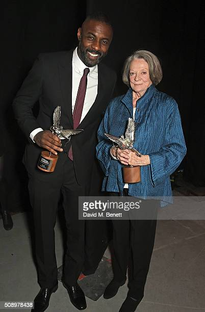 Idris Elba and Dame Maggie Smith attend the London Evening Standard British Film Awards at Television Centre on February 7 2016 in London England