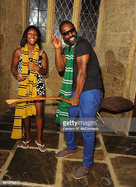 Idris Elba and Daughter attend a VIP screening of Harry Potter And The Philosopher's Stone at Leavesden Studios on July 1 2014 in Watford England
