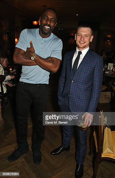 Idris Elba and Jack O'Connell attend Harvey Weinstein's preBAFTA dinner in partnership with Burberry and GREY GOOSE at Little House Mayfair on...
