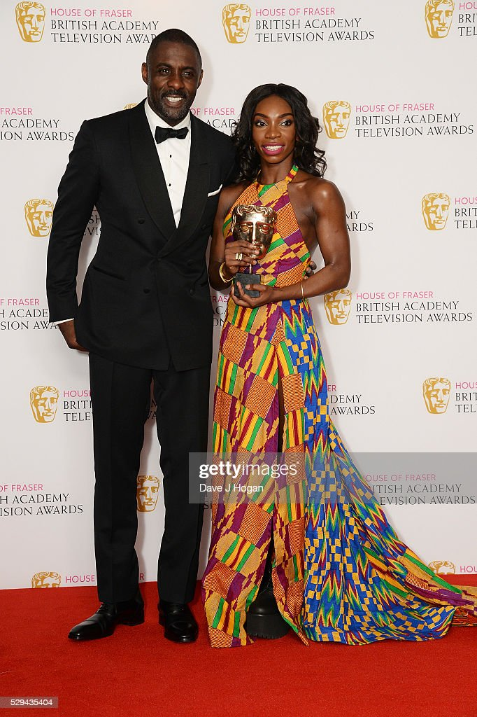 Idris Elba (L) and Michaela Coel, with the award for Breakthrough Talent, pose for a photo during the House Of Fraser British Academy Television Awards 2016 at the Royal Festival Hall on May 8, 2016 in London, England.