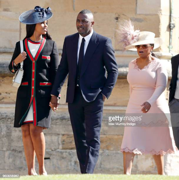 Idris Elba and Oprah Winfrey attend the wedding of Prince Harry to Ms Meghan Markle at St George's Chapel Windsor Castle on May 19 2018 in Windsor...