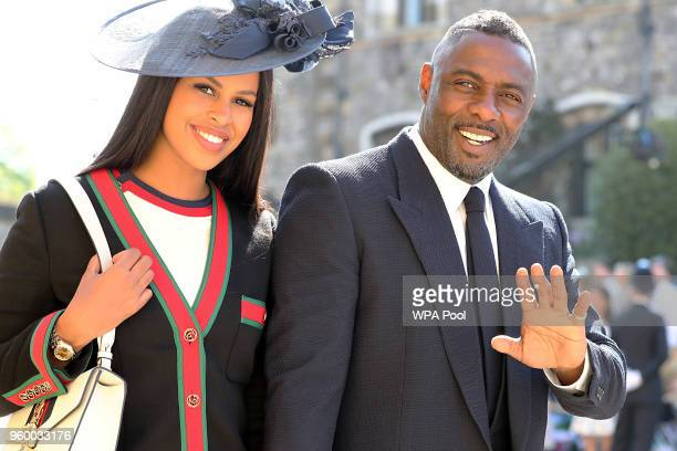 Idris Elba and Sabrina Dhowre arrive at St George's Chapel at Windsor Castle before the wedding of Prince Harry to Meghan Markle on May 19 2018 in...
