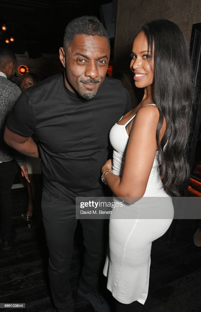 Idris Elba (L) and Sabrina Dhowre attend Idris Elba's Christmas Party at Kadie's Cocktail Bar & Club on December 9, 2017 in London, England.